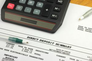 11546690 - direct deposit summary with calculator and pen