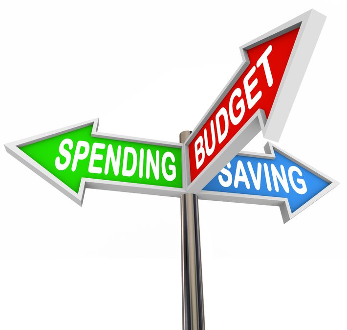 16261450 - three road signs pointing to spending, saving and budget to symbolize budgeting and savings in your personal finance for long term financial goals or retirement