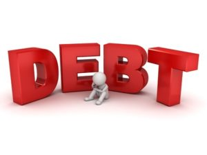 39715878 - 3d man sitting with red word debt isolated over white background