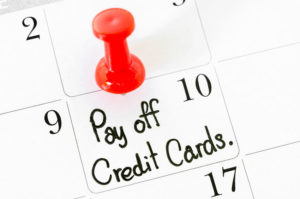 51612147 - the words pay off credit cards written on a calendar.