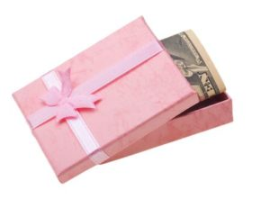 6242777 - beautiful pink gift with money anknotes isolated on white background